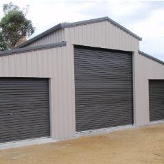 American barn clad with monoclad/trinclad fixed vertically.