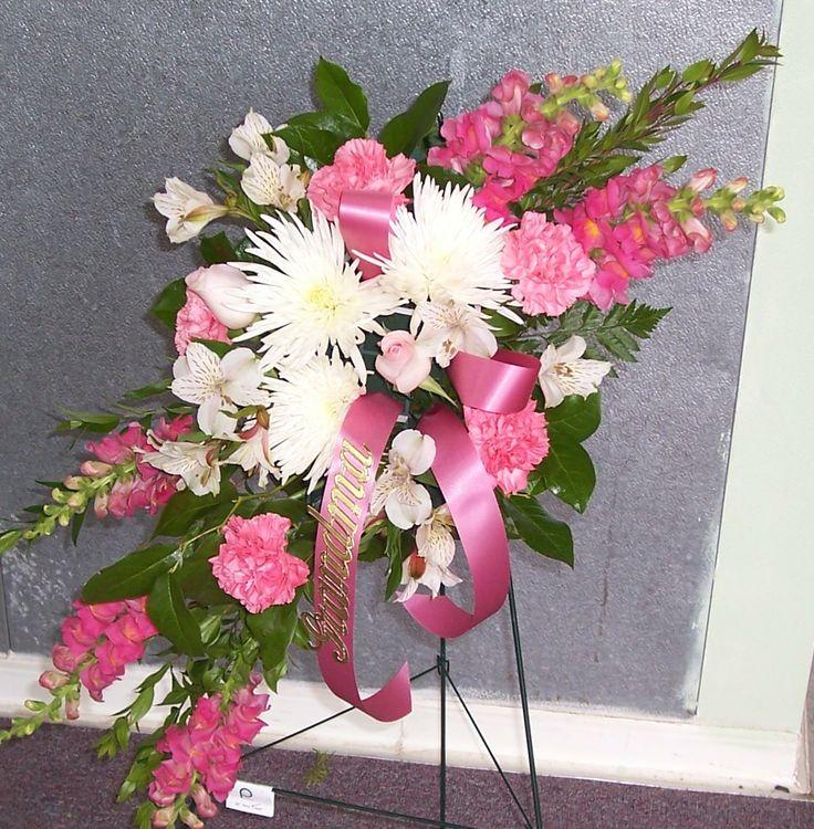 funeral flowers | Behind
