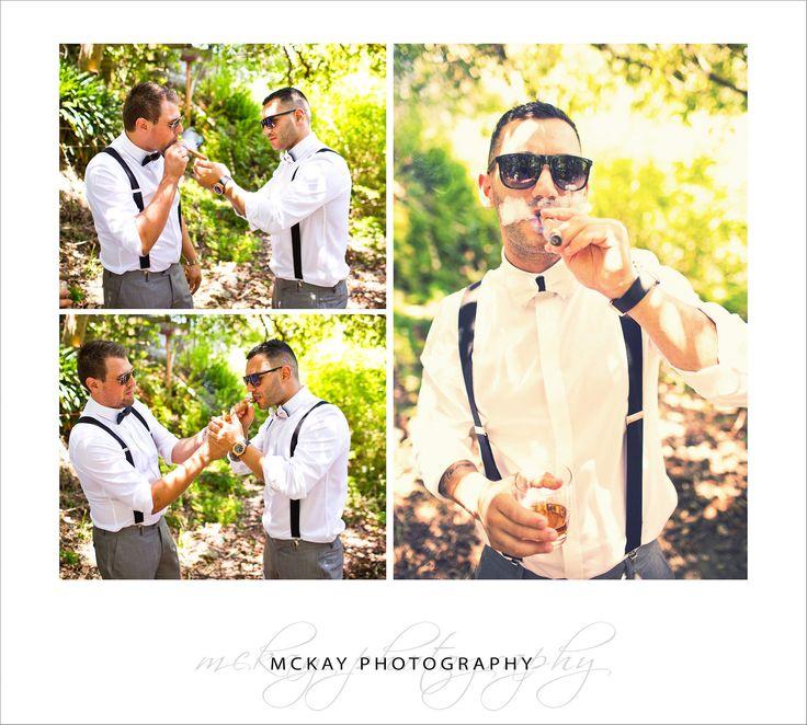 Alex lights up a cigar- wedding photography Clontarf Beach & Zest at the Spit Mosman - by McKay Photography  http://www.mckayphotography.com.au  #zest #wedding #groom#weddingphotography