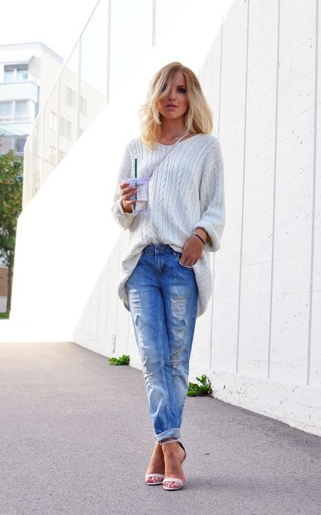 Oversized sweater, ripped boyfriend jeans, and heeled sandals