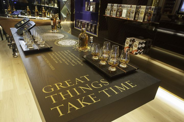 The Whisky Shop flagship store by gpstudio, in London - interactive tablets tell stories to accompany product tasting