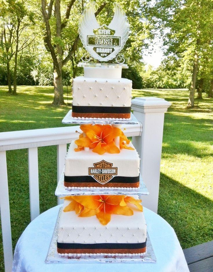 Harley Davidson theme wedding cake - Harley Davidson themed wedding cake - buttercream iced, silk flowers. Thanks for looking! Lisa