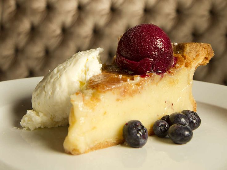 The combination is startling but works, the sweet-tart zing of the summer-ripe berries, infused with red wine vinegar, brown sugar and clovey pie spice, cutting through the richness of tangy buttermilk custard over a crust that crumbles with a little earthy cornmeal. Image Only