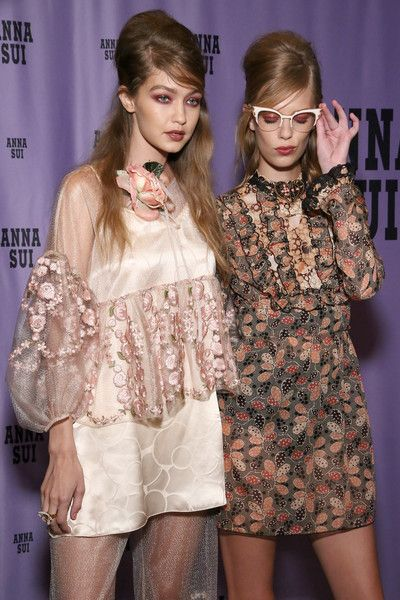 Model Gigi Hadid (L) and a model pose backstage at the Anna Sui fashion show during New York Fashion Week: The Shows at The Arc, Skylight at Moynihan Station on September 14, 2016 in New York City.