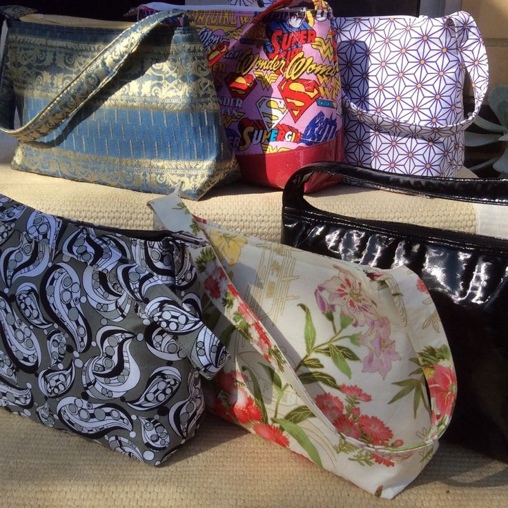 NEW handbags added to the Made for Me store! Get some 'girl power', beautiful blue & gold, eclectic purple daisies or tan faux leather with satin.  Something unique and crafted for you