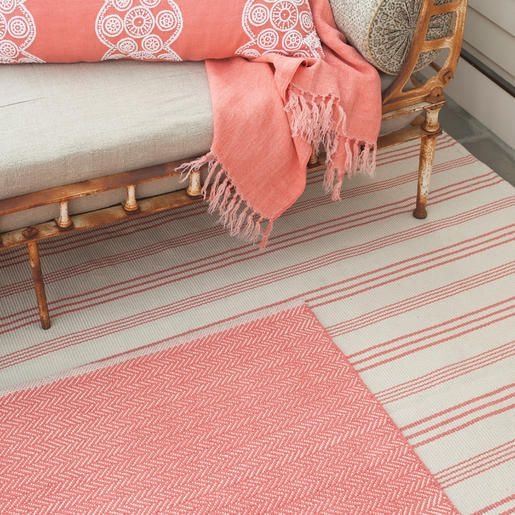 A fresh twist on our customer favorites  Swedish Stripe and  Denmark Stripe, this woven cotton rug features an elegant coral stripe on a natural cotton background.