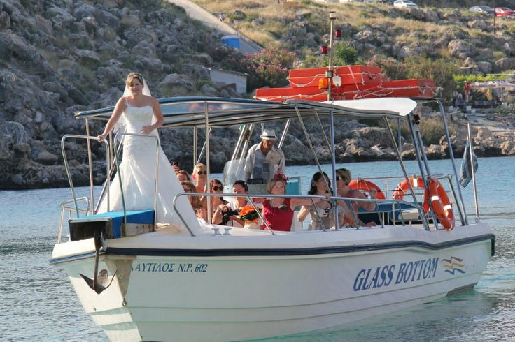 Bride and get girls arrive by boat to St. Paul's bay, Lindos. Image by Avalon photography Rhodes