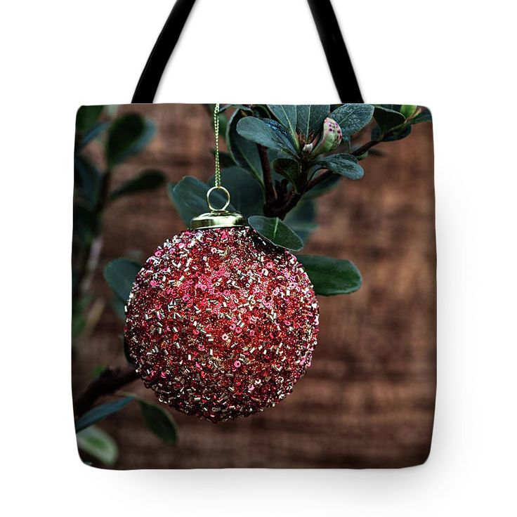 Tote Bag featuring the photograph Hanging Red Ball by Evgeniya Lystsova. Red Christmas Ball Hanging on the Plant in December, Winter Holiday Concept. Nice Bag for you, nice Gift for a friend. See more winter Holidays styles in my gallery. #ToteBag #Fashion #Christmas #Accessories #LifeStyle #Gifts #Decorations