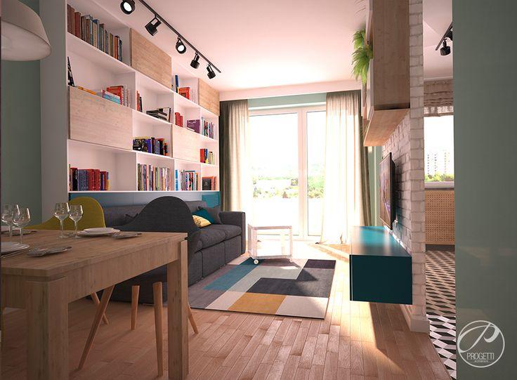 Kolor w mieszkaniu. Projektowanie mieszkań Warszawa.  Salon w stylu nowoczesnym. Kolorowe dodatki oraz elementy dekoracyjne wykonane z drewna tworzą niepowtarzalne wnętrze. | Progetti Architektura