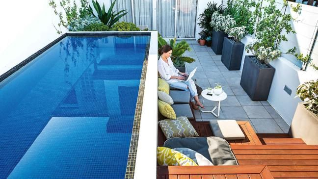 A Small Rooftop Garden On A City Terrace Showcases Smart Space Use And It S Designed Around A Pre Existing Swimming Pool Designs Pool Landscaping Pool Designs