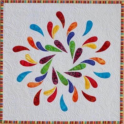 This woman in Australia makes really interesting quilts.  Love the colors and the shapes!
