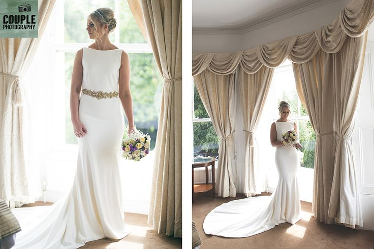 The bride in the windowlight in her elegant Folkster dress. Wedding at Summerhill House Hotel by Couple Photography.