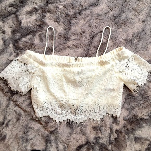 Top Shop Lace Crop Top NWT cream lace crop top!   Purchased while in Chicago but is a bit too short for my comfort now.   Pretty lace detail throughout entire top.   Lined so isn't see-thru.   Back zip closure.   US sz 2 Petite.   Will prob work best for sz Xxs or XS.   Pair w some high waisted shorts or a skirt  Topshop Tops Crop Tops