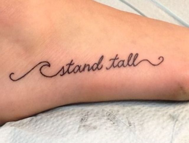Stand Tall Text Tattoo on Foot - Fashion Today