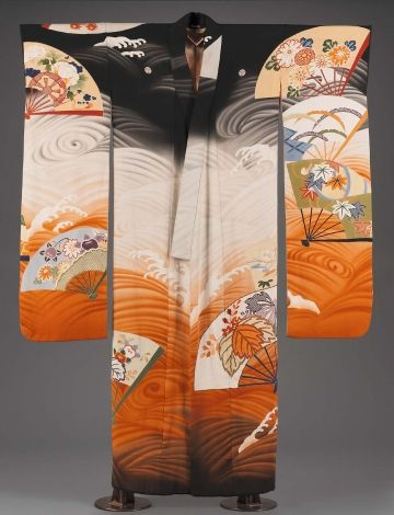 """Long-sleeved robe (furisode) with overall, large-scale design of fan shapes decorated with auspicious motifs in blue, green, orange floating on a black, orange and white ground of swirling waves. Five crests with three heart-shaped leaves turned inward (symbol of shogun families). Interior label: """"Made in Japan,"""""""