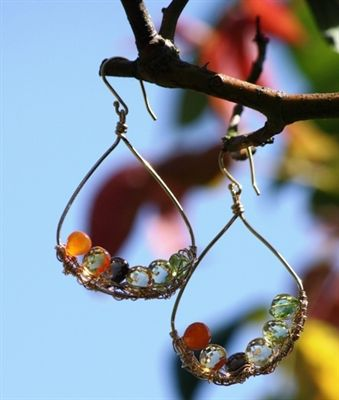 Aleita Jewelry - A lovely assortment of gemstones; Carnelians, Peridot, Green Amethyst, Citrine & Smokey Quartz hanging from hand crafted gold ear wires