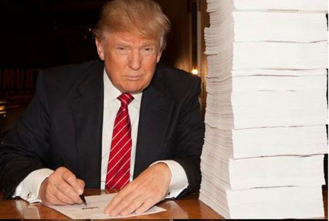Donald Trump signs his tax return last fall. Trump says he won't release his tax returns before election  | Trump presidential campaign via AP