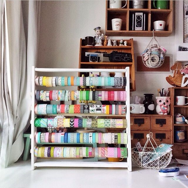 Washi tape holder.  Use for spools of ribbon?  Looks like it can be wall mounted or set on a table top.