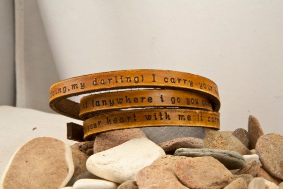 3x - 4 x ultra long leather customizable wrap bracelet. This one says i carry your heart with me(i carry it in my heart)i am never without it(anywhere i go you go,my dear;and whatever is done by only me is your doing,my darling) I carry your heart, I carry it in my heart.