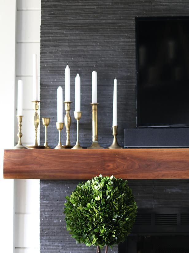 Modern Walnut Mantels in contemporary homes are known for looking sleek and seamless. In this rustic modern home in North Georgia, a floating-style mantel was made from walnut. Its streamlined look has been polished and smoothed out to add visual tension against the rough and rustic stacked-stone wall.