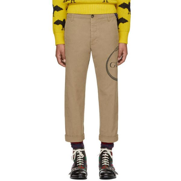 Gucci Beige Ouroboros Logo Chinos ($775) ❤ liked on Polyvore featuring men's fashion, men's clothing, men's pants, men's casual pants, beige, mens chino pants, mens chinos pants, mens slim fit pants, gucci mens pants and mens slim fit chino pants