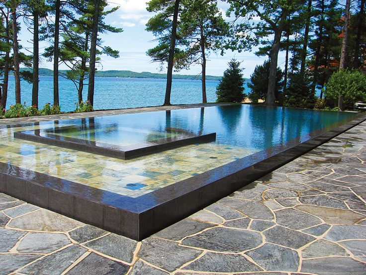 how about this rectangular pool with raised spa by acme pool construction inc