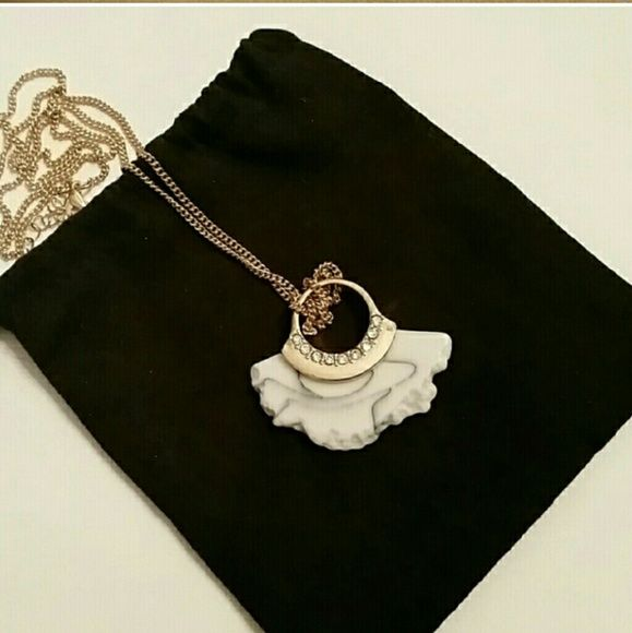 Long gold chain with white marble pendant Gold chain with pendant of white marble with Diamond like stones to accent it  New, without tags Pouch not included, was only used as a backing for the photo.  *marble waves may vary slighlty, I have several of these to sell Jewelry Necklaces