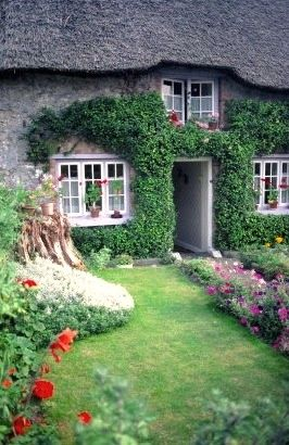 """Adare Cottage in County Limerick. In Irish """"Adare"""" is """"Ath Dara"""" meaning """"ford of the oak"""". It is known as one of Ireland's prettiest villages."""