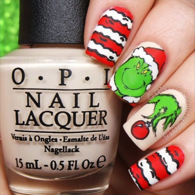 These are a recreation of @leximartone's grinch nails! She's too good. Go check her out. You're A Mean One Mr Grinch - How The Grinch Stole Christmas ❤️❤️❤️ @opi_products Alpine Snow, My Vampire Is Buff, and Matte Top Coat @twinkled_t #00 nail art brush   10% off with code CAMBRIA Lots of acrylic craft paints @shopkeeki The Grinch nail decals