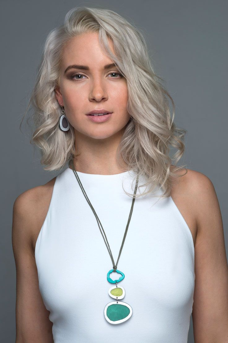 Skimstone necklace - Green. Dramatic, and eye catching our Skimstone necklace is simply stunning - perfect for any special occasion. It comes in two colours Green and Natural, and looks amazing worn with neutral block colours. Three irregular shaped metal and resin rings drop elegantly from an adjustable cord. Teamed with our Riverstone earrings and rings, it is the perfect accessory for making a statement.
