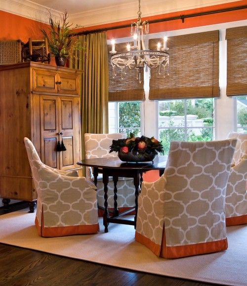 beautiful color, texture and pattern in this dining room. also love the fabric and band of orange on the bottom chairs.
