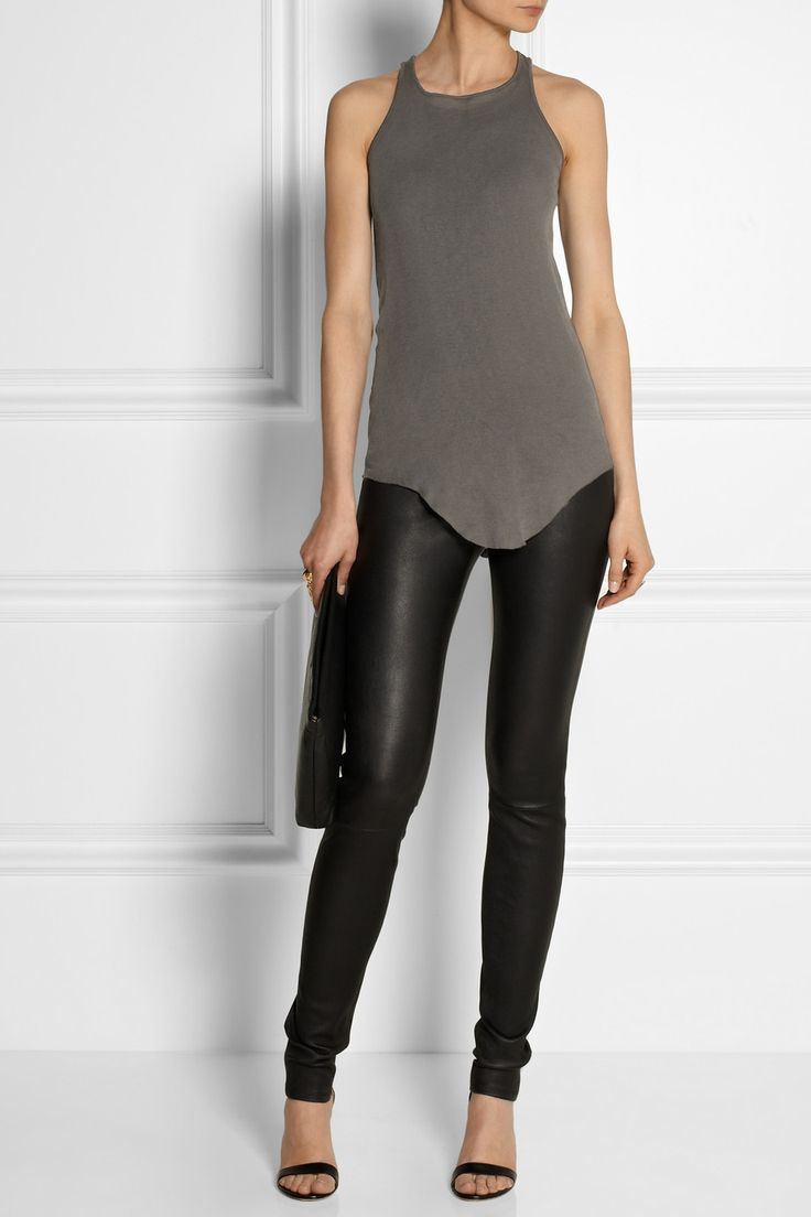 RICK OWENS Cotton-jersey tank $260 EDITORS' NOTES & DETAILS Cut from soft cotton-jersey and cut with a raw, curved hem, Rick Owens' gray tank is ideal for layering. Wear this semi-sheer style with leather pants, layering it under cozy sweaters and leather jackets when the weather cools.