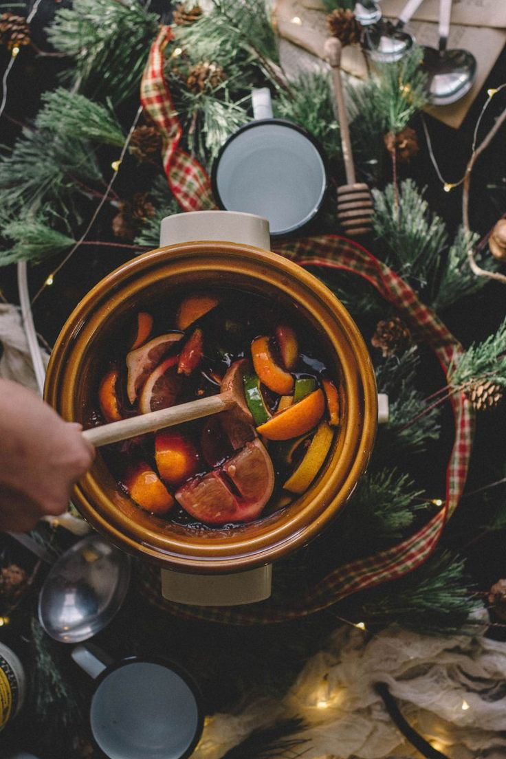 What I love about mulled wine is its lack of difficulty. All you do is throw everything into the slow cooker, turn it on high, and leave it! Seriously, it's