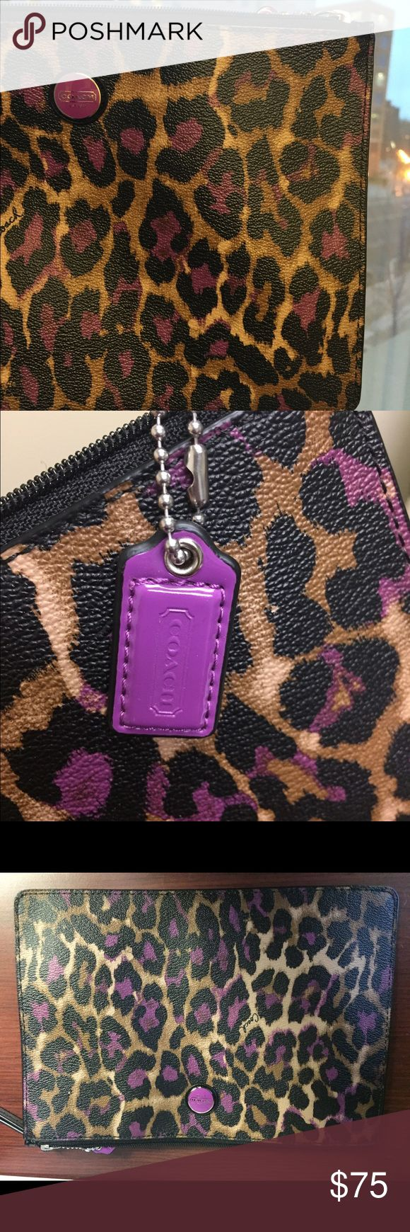 Brand new Coach clutch leopard cheetah with purple 100% authentic Coach clutch in leopard print with fun purple details and zipper closure! Great for traveling or carrying on a night out! Never carried and zero wear and tear. The inside is black with a pocket. Coach Bags Clutches & Wristlets