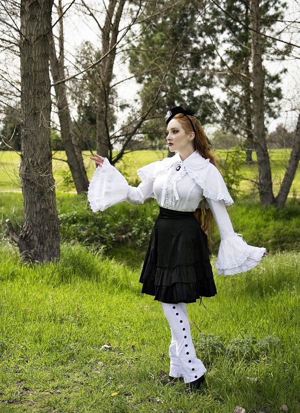 I noticed a couple of credit errors in the International Steampunk Fashions book. In this picture, this is actress and singer, Scarlett Pomers, modeling the White Blouse and Capelet with Mini Bustle Skirt.