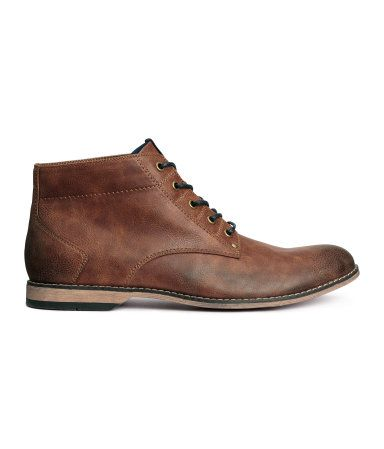 Ankle-high boots in imitation leather with laces at front. Rubber soles.
