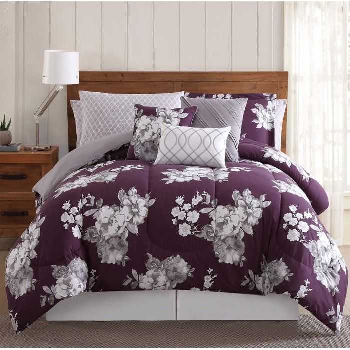 Etched floral pattern on a purple background. The accent print is a printed lattice pattern in White/Gray. The added accessories help you complete the bed and include sheet sets and decorative pillows.