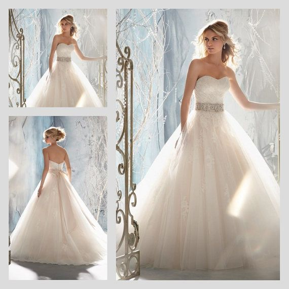 Queen Strapless Princess Delicate beading and rhinestones Ball Gown. Available in multiple colors!