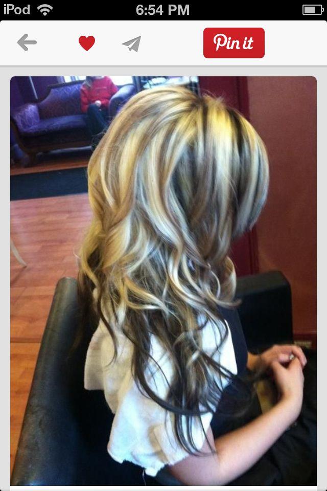 Hair blond dark brown highlights with dark brown underneath