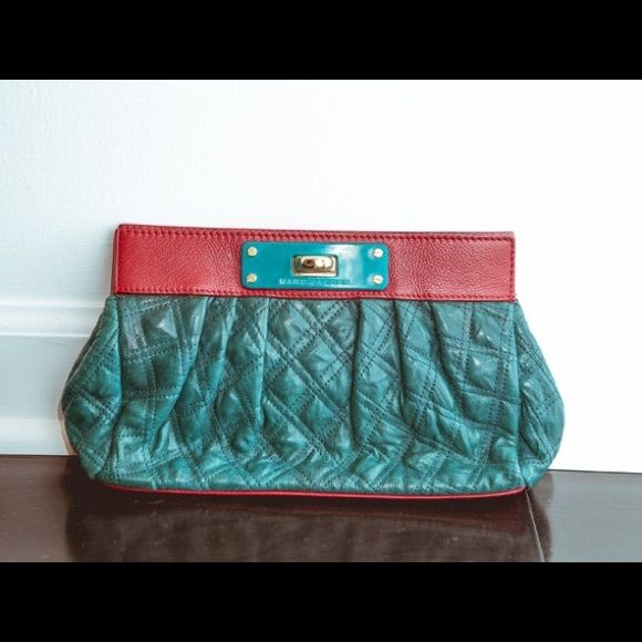 Marc Jacobs Clutch Marc Jacobs clutch in real with burgundy details and gold hardware. Good condition was one of my favorite bags. Marc by Marc Jacobs Bags Clutches & Wristlets