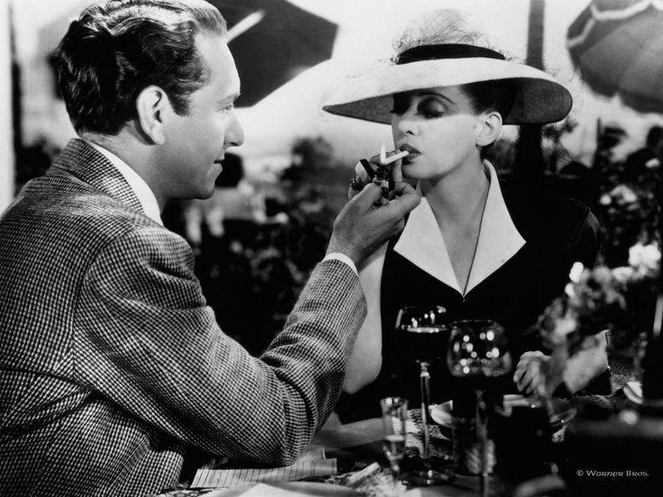 Bette Davis & Paul Henreid in Now, Voyager. one of my favorite old movies!