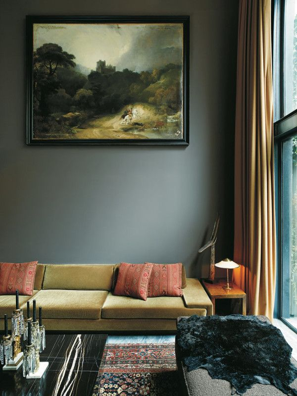 A green mohair sofa designed by Fernando Santangelo adds a bolt of color to James Oakley's dark and sophisticated west village townhouse | via @natmarchbanks