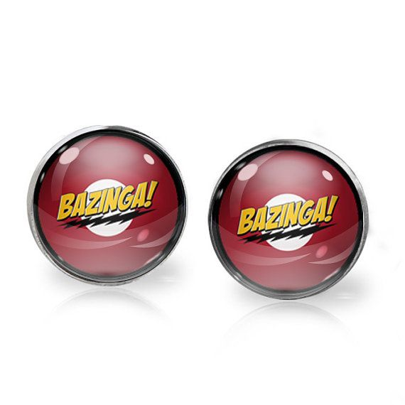This listing is for ONE pair of Bazinga! stud earrings inspired by The Big Bang Theory. A perfect gift for the fangirl in your life!   These earrings measure 14mm in diameter and utilise glass domes to magnify high quality images set beneath. They are made using high quality surgical steel ear posts for sensitive ears. This listing is part of our Buy THREE get ONE free promotion. Purchase any three pairs of earrings in the promotion and receive one pair of your choice free. Please DO NOT…