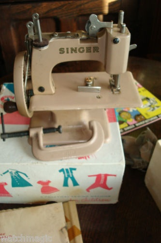 Adorable little pink singer toy sewing machine