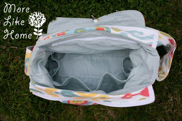 More Like Home: Stroller Friendly Diaper Bag {free pattern & tutorial} - very detailed and customisable http://www.morelikehome.net/2014/07/stroller-friendly-diaper-bag-free.html