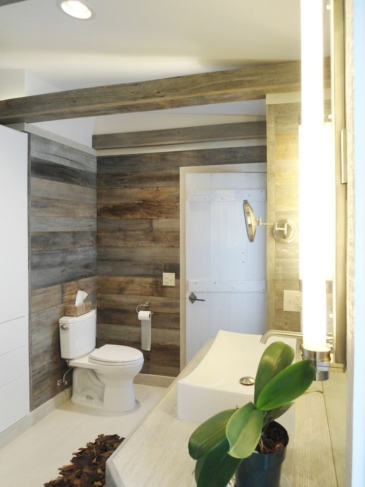 The reclaimed Barn Siding wraps all of the master bath's walls as well as the box beams at the ceiling.  The beams are hollow and incorporate lighting in them to illuminate the ceiling.