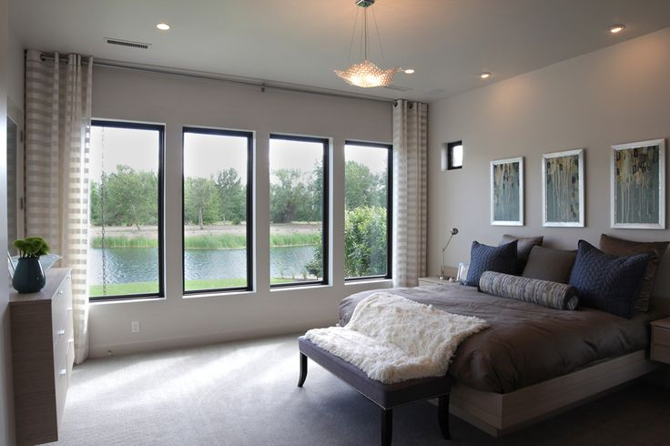 Renovare Model Home. Master Suite that has waterfront views, a luxurious en suite bathroom and spacious walk-in closet.