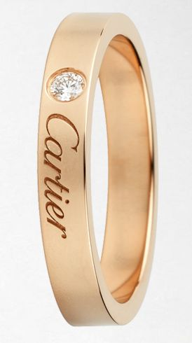 Cartier in 18k gold with a diamond.