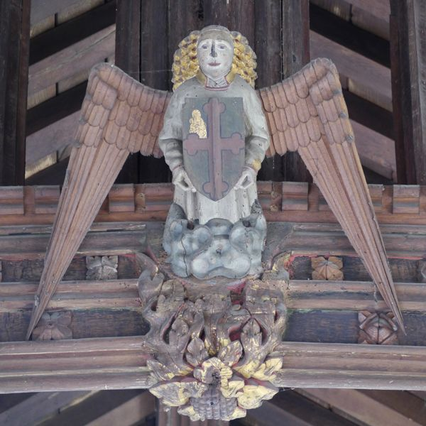 Pilton St John Baptist: one of the angel bosses in the centre of the tie-beams of the nave roof.
