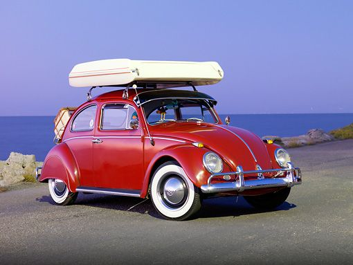 AUT 22 RK2828 01 © Kimball Stock 1964 Volkwagen Beetle Red With Topper Tent 3/4 Front View On Pavement By Ocean
